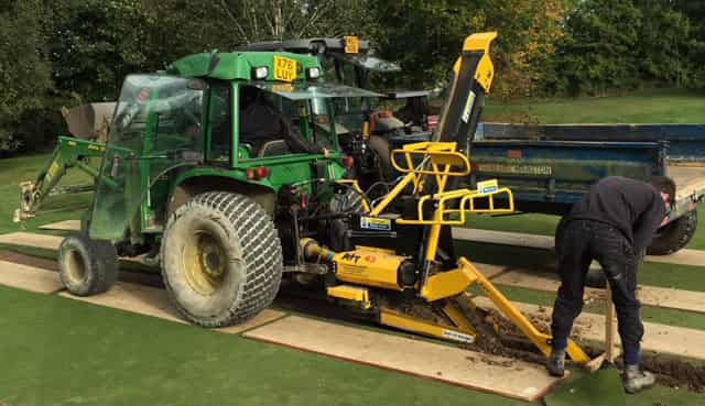 Trencher at work on a golf course